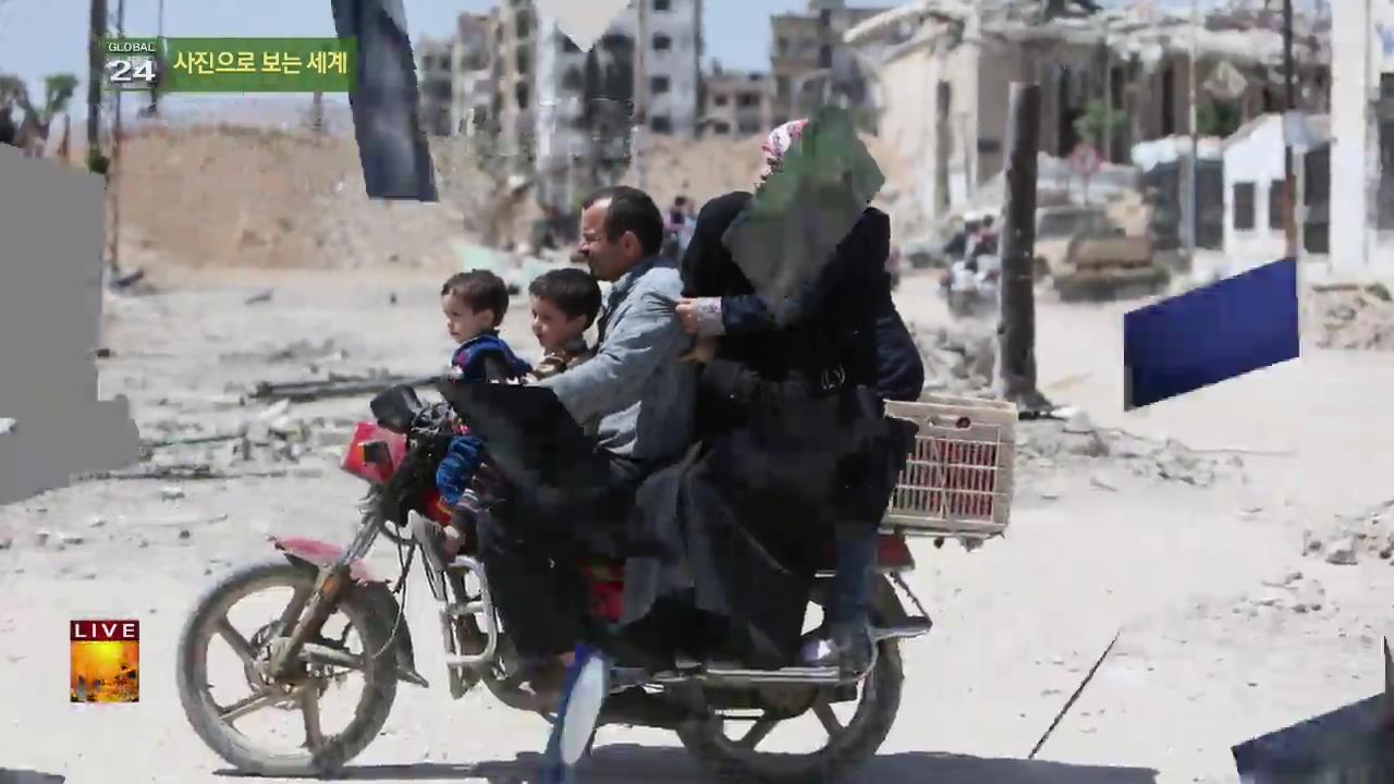 [글로벌 24 사진] 모터바이크 타고 가는 가족 외